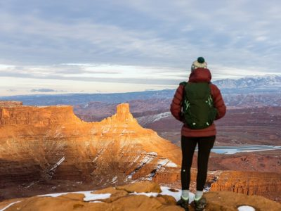Woman looks at Dead Horse Point State Park in the winter
