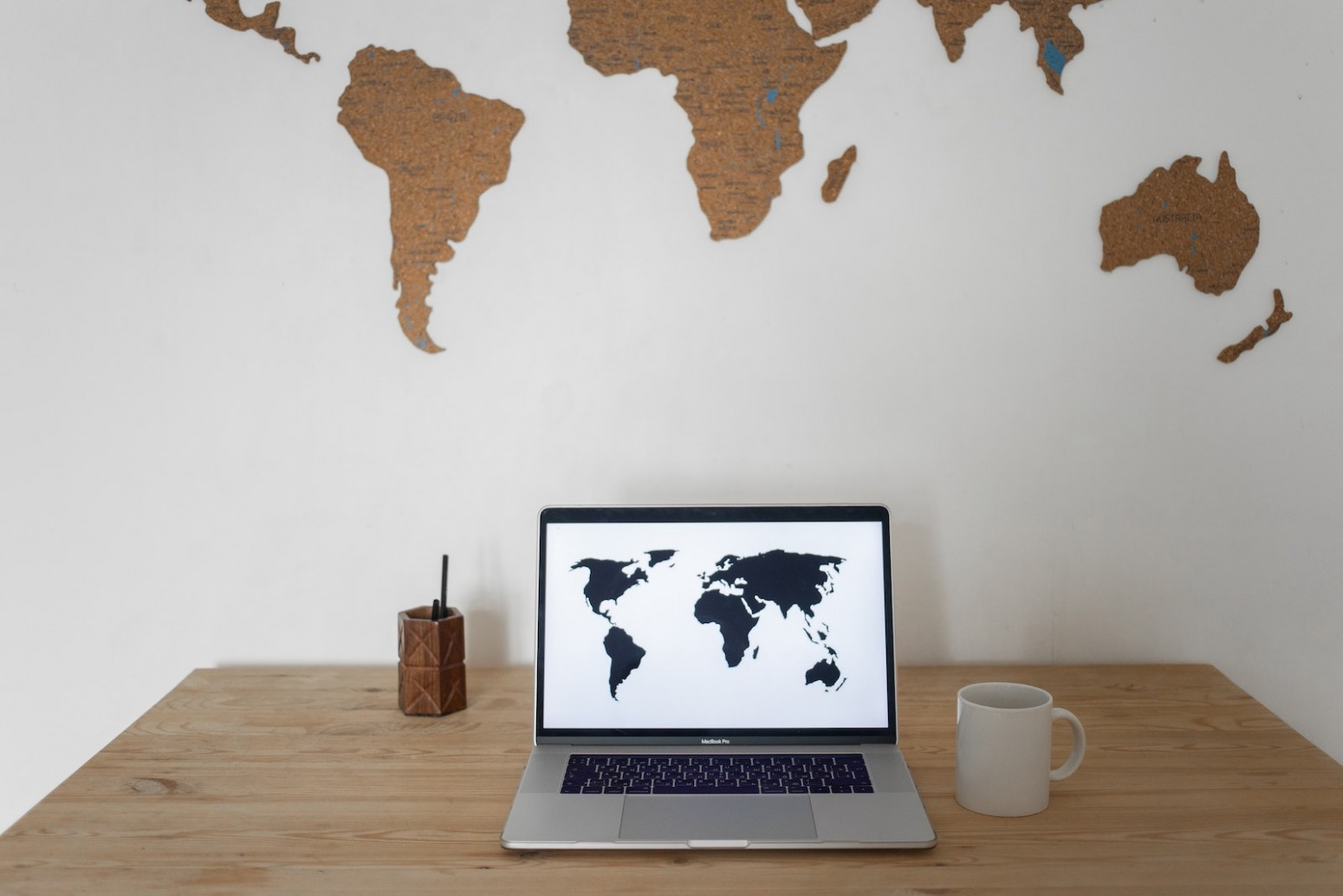 laptop with global maps